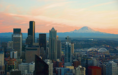 Mt.Rainier eclipsing Seattle downtown from Space Needle (WorldofArun) Tags: world ocean seattle city light sunset shadow urban mountain art history nature architecture night skyscraper wonder landscape lights evening washington nikon scenery downtown cityscape pacific zoom scenic neighborhood mount disk needle rainier sound belltown planet spaceneedle pugetsound flyingsaucer monorail elliottbay 2008 westcoast volcanic cascade 1962 i90 bellevue mothernature mountbaker observationdeck cindercone worldfair cascaderange stratovolcano icecap lavadome seattlemonorail 18200mm shieldvolcano cascadevolcanoes pacificringoffire nikond40x yenumula cascadevolcanicarc worldofarun hoveringdisk cascadearc arunyenumula