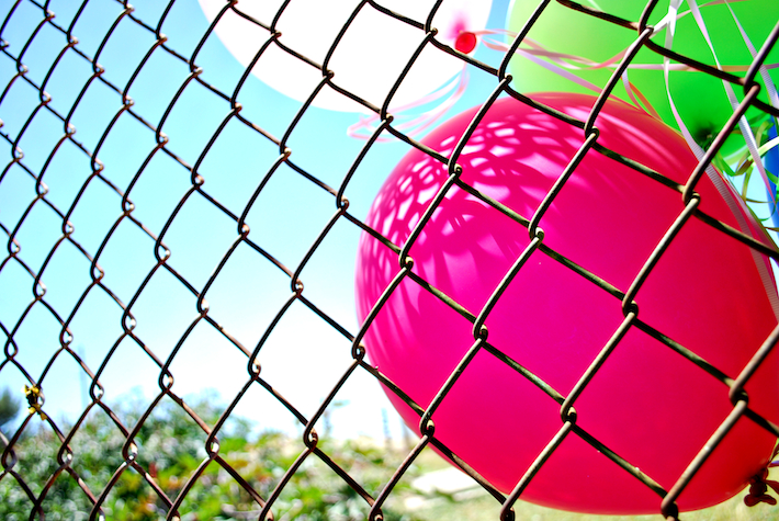 Fenced Balloons.