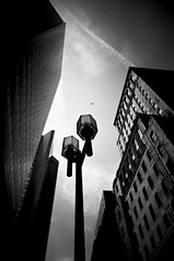 vignettes (pros and cons) (stephane (montreal)) Tags: sky white black building monochrome architecture plane photography noir photographie montreal ciel lamppost et vignette blanc ville avion lampadaire stephane urbaine photographe paquet 2011 urben