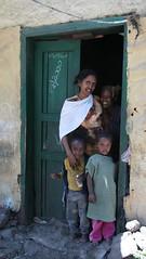 outside the shop (ellybrown) Tags: smile shop group rubble wollo amhara kombolcha
