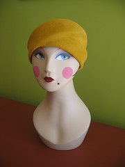 Mimi with mustard color cloche hat