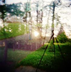The Tripod Walks (Dead  Air) Tags: park trees sky baby sun sunlight grass portland holga dusk stroller tripod stjohns lightleaks sciencefiction exposures hgwells stjohnsbridge cathedralpark johnchristopher