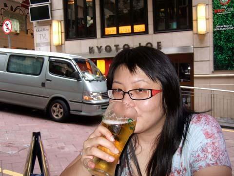 Suanie drinking Carlsberg in Lan Kwai Fong, Hong Kong
