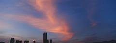 colorful cloud (* andrew) Tags: blue sunset sea sky panorama cloud building tower film water silhouette architecture hongkong waterfront kodak rangefinder slide hasselblad 100 vs ektachrome e100vs xpan 45mm wanchai e100 file:name=20080709xpan013jpg