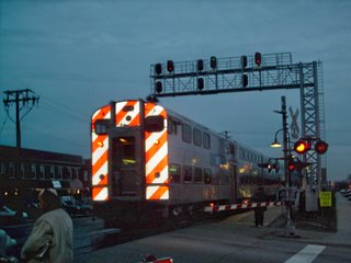 Westbound Metra commuter local departing the Berwyn commuter rail station on South Oak Park Avenue. Berwyn Illinois. March 2007.