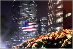 American Flag at Ground Zero (9/11) (Linus Gelber) Tags: nyc flowers newyork night memorial nightscape flag 911 broadway americanflag twintowers gothamist september11 groundzero september11th 911memorial libertystreet zucottipark gsubby122109