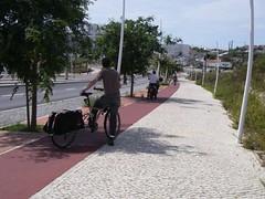 What happens at a sidewalk bike lane