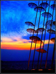 colored umbrellas (maios) Tags: blue sunset red sea sky sculpture sun art water metal port umbrella greek design boat photo europa europe flickr ship colours photographer hellas olympus explore note greece macedonia thessaloniki fotografia salonica thermaikos manikis artisticexpression maios makedonia iosif   heliography    golddragon  mywinners abigfave zogolopoulos    anawesomeshot colorphotoaward  ysplix theunforgettablepictures betterthangood goldstaraward        grouptripod creattivit    iosifmanikis