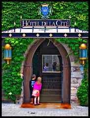 Wonderland Hotel (Sator Arepo) Tags: door leica reflection facade 50mm hotel mirror wooden reflex gate alice streetphotography ivy medieval wonderland curiosity carcassonne tale 25mm digilux cite hesitation hoteldelacite digilux3