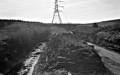 Woodhead Portals at Dunford Bridge - 1988 (Another Partial Success) Tags: blackandwhite abandoned yorkshire moors tunnels dereliction pennines woodhead transpennine devestation penistone disusedrailway greatcentralrailway oldraiway nationalgrid abandonedrailway abandonedstation woodheadroute smashedwindows edwardwoodward dunfordbridge woodheadtunnels doneforbridge abandonedsignalbox