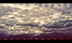 Sunday Morning (isayx3) Tags: sunset mountains clouds sunrise 50mm nikon rays 18 d3 fifty nifty 50mmf14d challengeyouwinner