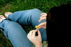 Beauty is in the eye of the Flower Holder (sketchinist) Tags: blue brown green grass hair back head manhattan ks holly dandelion jeans flip flops