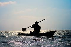 Afterglow (-Passenger-) Tags: ocean sunset sea silhouette fisherman canoe rowing caribbean backlighting santacruzdelislote