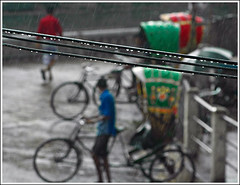 Seasonal Tears [..Narayanganj, Bangladesh..] (Catch the dream) Tags: street urban water rain season drops wire asia bongo drop rainy monsoon hanging pearl rickshaw bengal bangladesh peril bangla downpour rainyseason bangladeshi hardship bangali saarc narayangonj aplusphoto gettyimagesbangladeshq2