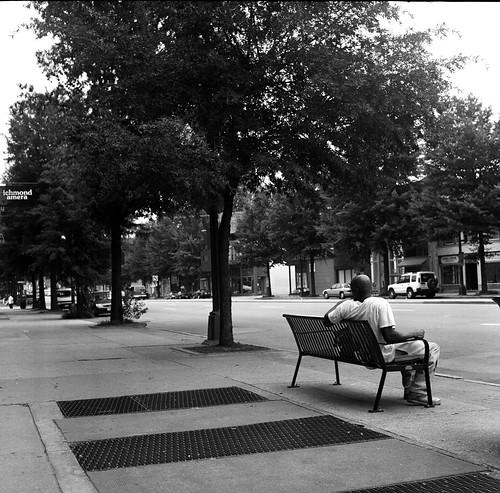 main waiting at bus stop