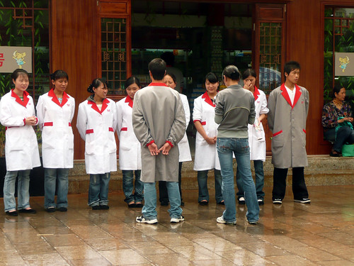 Sell, Sell, Sell - Shop staff on parade in China