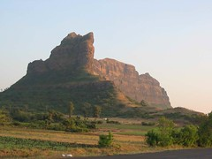 A golden hue of the Saptashrungi hill, before the sunset.