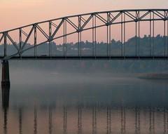 Early Morning River Bridge (Don3rdSE) Tags: trip railroad bridge pink blue autumn color fall water train sunrise river landscape dawn interesting october iowa explore ia mississippiriver dubuque predawn levee waterscape canong9 don3rdse