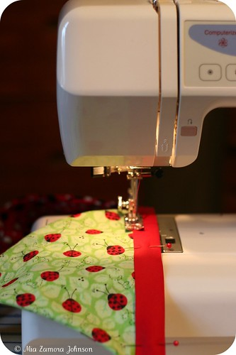 Sewing the ladybug garland