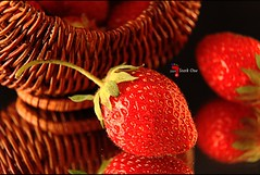 Strawberry Reflections (Craig - S) Tags: red reflections mirror stem berry basket straw strawberries seeds wicker golddragon canoneos50d