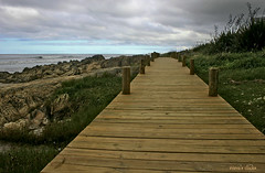 The boardwalk (nina's clicks) Tags: wood sea sky grass clouds canon mar madera rocks camino pasto cielo nubes boardwalk rocas