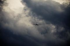 Air Canada 767 heading right for the storm (HANGAR ENT.) Tags: toronto ontario canada storm sunshine clouds dark airplane flying international boeing thunder pearson 767 austrian yyz winglets cyyz