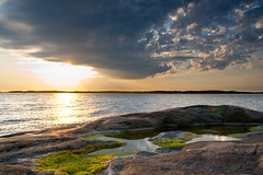 Finnish summer (Henrik Kalliomki) Tags: ocean sunset sea sky cloud sun reflection nature water grass rock canon finland landscape evening balticsea southcoast kirkkonummi canoneos400d porkkalabay
