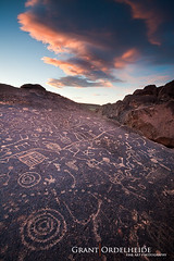 Bishop Petroglyphs (Grant Ordelheide) Tags: old sunset people orange mountains color art history ancient highway pattern time monolake lenticular bishop hieroglyphs petroglyphs owensvalley 395 mttom easternsierra alabamahills 2011 grantordelheide