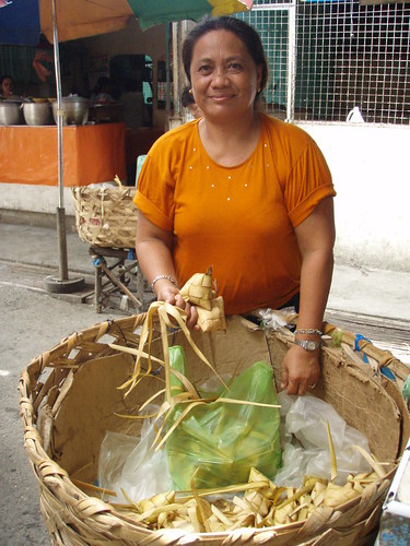 Street vendor sells puso, hanging rice, a traditional snack food, in Carcar Market, Cebu, Philippines Buhay Pinoy  Ngayon Filipino Pilipino  people pictures photos life Philippinen