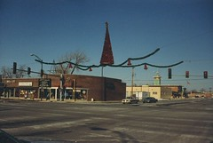 The corner of West 95th Street and South kedzie Avenue during the Christmas Holiday Season. Evergreen Park Illinois. December 1988.