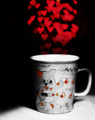 day #30/? - a cup of heart shaped bokeh. (*northern star) Tags: red cup canon hearts 50mm lights heart bokeh experiment explore teddybear mug lovely cuori rosso cuore day30 tazza bedsidetable esperimento lenshood northernstar comodino orsetto cappuccio lucine explored donotsteal eos450d allrightsreserved northernstarandthewhiterabbit northernstar shapedbokeh tititu digitalrebelxsi eff18ii graziecara hmdiw unmesedihmdiw bokehaformadicuore tuttoiodevofare usewithoutpermissionisillegal northernstarphotography ifyouwannatakeitforpersonalusesnotcommercialusesjustask