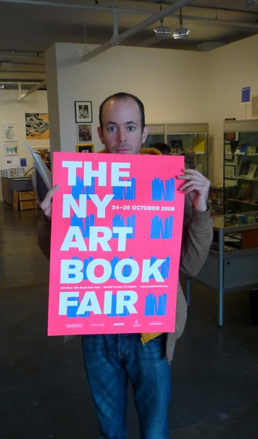 Mark behind a poster for NY Art Book Fair by Mark_Baratelli
