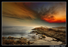 Splitted Sky... (Falcon EyE) Tags: longexposure nightphotography sunset red summer sky cloud brown abstract reflection art nature stone night clouds dark landscape gold golden harbor fishing fisherman nikon perfect colorful sailing photographer outdoor horizon dramatic quay ciel citylights syria float soe hdr fasting  syrien syrie aclass lattakia  18135  lowlightphotography seasunset d80 abigfave nikond80 seasunclouds darknightphotography waseemasmar seaacape   photosfromsyria photosfromlattakia  fotodilattakia
