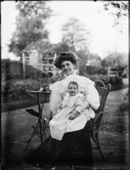 Portrait of woman with infant (Powerhouse Museum Collection) Tags: woman baby white smile smiling fashion pose garden outside happy model chair child lace smiles happiness jar wicker bonnet offspring powerhousemuseum womensday glassplatenegative xmlns:dc=httppurlorgdcelements11 dc:identifier=httpwwwpowerhousemuseumcomcollectiondatabaseirn381260 rusticbonnet 18851900