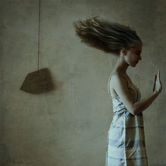 against the wind (brookeshaden) Tags: selfportrait texture sign hair neck out dress darkness wind profile blow direction stop squareformat grimace windblown nikond80