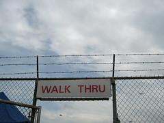 Walk Thru (Steve and Sara) Tags: sign fence gate garage alabama nascar barbedwire infield deutsch talladega walkthru aarons499 nascarsprintcup