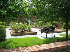 Rose garden (Pandorea...) Tags: trees roses sculpture lake pope brick green grass rose garden bench landscape design iron beds cast edge residential lakehouse parterre crapemyrtle jollyrobertslandscapearchitect
