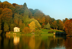 Autumn sunset at Stourhead gardens in Wiltshire (Anguskirk) Tags: uk autumn trees sunset england lake color colour building english fall nature leaves yellow architecture rural forest woodland garden temple evening afternoon sundown country eu stourhead british hillside wiltshire nationaltrust reflectiion blueribbonwinner cherryontop anawesomeshot favoritegarden goldenheartaward