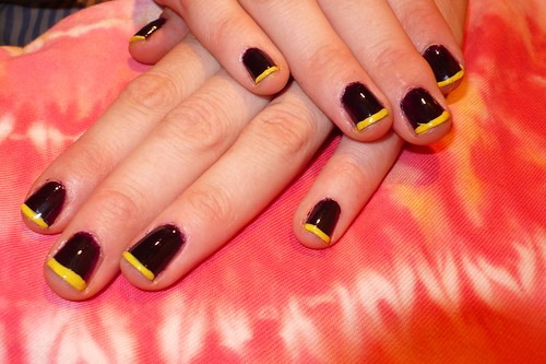 Dark purple nails and lemon yellow tips nail design