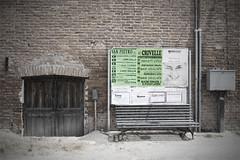 Door, Posters, Bench (-LucaM- Photography WWW.LUCAMOGLIA.IT) Tags: bus del stop pullman desaturation porta vignetting portone feste panchina pulman manifesti morti fermata corriera sagre vignettatura mywinners abigfave desaturata rubyphotographer