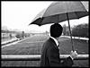 The avenger's face (Sator Arepo) Tags: bridge blackandwhite bw face rain umbrella river fuji secret rainy finepix spy fujifilm agent british espionage gentleman compact lleida seuvella avenger segre lerida f31 f31fd fujifilmf31fd retofz090217 gettyimagesspainq1 iberiastreets gettyimagesiberiaq2 gettyimagesiberiaq3