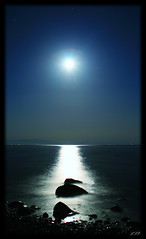 Once in a Blue Moon (Kuzeytac) Tags: longexposure travel light sea sky moon seascape black color colour reflection nature wet stone glitter night turkey skyscape twilight scenery view bright horizon trkiye turkiye aegean twinkle scene explore moonlit chapeau lonely leyla assos hava gkyz gece manzara turchia lsi yansma turkei k renk akam doa tabiat siyah anakkale lacivert parlt canoneos400d canoneosdigitalrebelxti ayvack prlt kuzeytac copyrightedallrightsreserved aqualityonlyclub