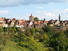 Surrounded by Towers - Rothenburg ob der Tauber, Germany (Batikart ... handicapped ... sorry for no comments) Tags: city travel autumn vacation castle fall canon buildings germany landscape geotagged bayern deutschland bavaria town reisen flora gate holidays village urlaub herbst meadow wiese stadt altstadt oldtown landschaft vacanze 2007 citywall canonpowershot middleage a610 f50 rothenburgobdertauber huser stadtmauer ansbach castlegate mittelfranken castlegarden mittelalter townwall tauber rothenburgodtauber canonpowershota610 burgtor romanticroad romantischestrasse 50faves stadtturm citytower viewonblack middlefranconia batikart