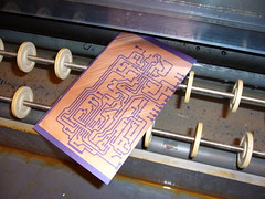 Etching away the exposed photoresist