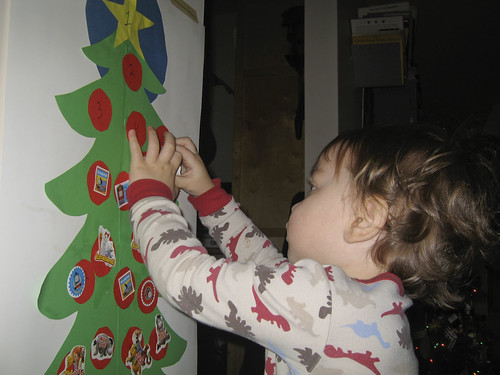 putting a sticker on his advent calendar