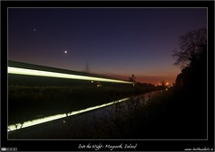 Into the Night (bbusschots) Tags: longexposure ireland moon reflection night train canal twilight venus rail railway astrophotography maynooth irishrail kildare royalcanal iarnrdireann