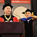 James Rogers, chairman, president and CEO of Duke Energy, receives his honorary doctorate as Chancellor Randy Woodson (left) reads his confirmation.