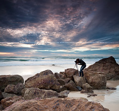 photographer by the ocean (Pawel Papis Photography) Tags: ocean camera morning woman beach rock person photo wave