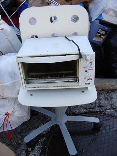 Sweet chair with filthy toaster oven.
