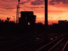 Nightshift begins (flickrknufflo) Tags: city sunset red berlin train dawn evening abend sonnenuntergang railway zug stadt dmmerung bahn gleis